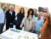 """بالصور.. حورية فرغلى وأحمد زاهر يحتفلان بـ""""الحالة ج"""" بإحدى شركات أكتوبر"""