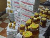"""بالصور.. """"مراقبة الأغذية"""" بسوهاج تضبط مخزنا لعسل نحل مغشوش"""