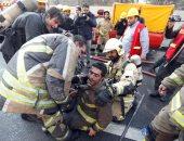 بالصور.. مصرع 40 شخصاً فى انهيار برج مكون من 15 طابقا بطهران