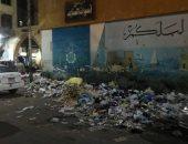 شكوى من تراكم القمامة بشارع المطار فى أسوان