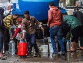 بالصور.. سيارات مياه متنقلة بشوارع الجيزة لتلبية احتياجات المواطنين