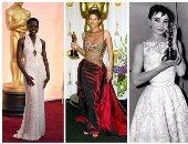 """بالصور.. أشيك 10 فساتين لا تنسى على السجادة الحمراء بحفلات الأوسكار.. فستان أودرى هيبورن عام 1954 من """"Hubert de Givenchy"""".. هالى بيرى بتصميم إيلى صعب عام 2002.. ولوبيتا بفستان تاريخى من 6 آلاف لؤلؤة"""