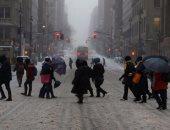 بالصور إلغاء رحلات  جوية وإغلاق مدارس مع بدء عاصفة ثلجية فى شمال شرق أمريكا