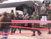 خروج آخر مجموعة من المسلحين والمدنيين من حى برزة بالعاصمة السورية دمشق
