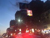 حريق داخل عقار فى شارع جامعة الدول العربية والإطفاء تحاول إخماده