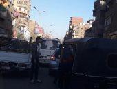 تلال القمامة تسبب شللا مروريا بشارع القومية العربية فى محافظة الجيزة