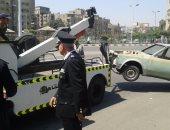 مرور القاهرة يرفع 13 سيارة ودراجة بخارية متروكة فى حملات موسعة بالشوارع