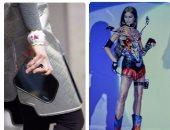 """بالصور.. تاريخ ارتباط عروض الأزياء العالمية بصناعة السيارات.. بيير كاردان أول من صمم أحذية السباق.. فيكتوريا بيكهام استوحت فساتين من """"رينج روفر"""".. وأزياء على شكل """"دواسات"""" آخر المحاولات فى ربيع 2017"""