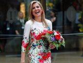 ملكة هولندا تتألق بفستان ربيعى أثناء مشاركتها فى مؤتمرالمرأة ببرلين