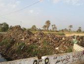 بالصور.. أهالى مركز مغاغة بالمنيا يشكون تراكم القمامة والحيوانات النافقة