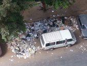 بالصور.. قارئ يرصد تراكم القمامة بشارع أحمد عرابى فى المهندسين