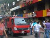 بالصور.. السيطرة على حريق محل بعقار فى شارع عرابى بالمهندسين دون إصابات