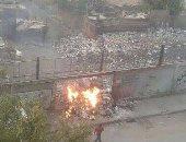 بالصور.. شكوى من حرق القمامة على مزلقان المترو فى عين شمس الشرقية