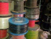 ضبط أعمدة وأسلاك كهربائية مسروقة في مخزن تاجر خردة بالإسكندرية