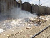 بالصور.. مواطنون يشكون من حرق القمامة فى المحلة الكبرى