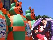 """بالصور.. موظف يعتذر لخطيبته بـ""""البالون شو"""" أمام مبنى حى ضواحى بور سعيد"""