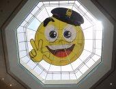 """تليجراف: شرطة دبى تضع إيموجى """"الابتسامة"""" على سقف المركز لنشر السعادة"""