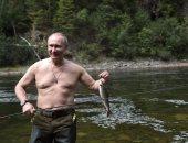 بالصور.. الرئيس الروسى فى رحلة صيد أسماك ناجحة فى سيبيريا الجنوبية