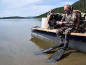 """""""فوتو سيشن"""" للرئيس الروسى فى مغامرة صيد أسماك فى سيبيريا"""