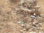 بالصور.. القمامة تتراكم بشوارع حدائق الأهرام والأهالى يستغيثون