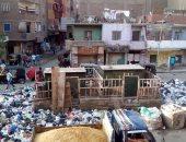 بالصور.. شكوى من انتشار القمامة بشارع الأقصر فى إمبابة