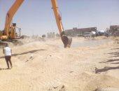 تطهير مخرات السيول وتحرير 71 محضر إشغالات بمركز ملوى بالمنيا