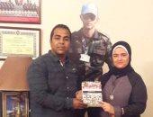 """بالصور.. النقيب محمود النوبى يُهدى أسر الشهداء كتابه """"تاريخ صنعه الرجال"""""""
