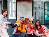 """بالصور.. """"الزومبى"""" يتجولون فى شوارع بريطانيا احتفالا بيوم غيبوبة المشى"""