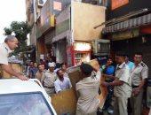 بالصور.. إزالة 350 حالة إشغال بأسواق مدينة أسوان استعدادا للموسم السياحى