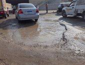بالصور.. تهالك نزلة الطريق الدائرى بمؤسسة الزكاة ومطالب بإعادة الرصف