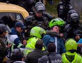 بالصور..اشتباكات عنيفة بين شرطة كولومبيا وسائقين محتجين ضد خدمة أوبر
