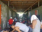 صور.. شرطة بابوا غينيا تغلق مركز احتجاز أسترالى يقيم فيه لاجئين