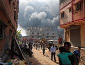 صور.. حريق هائل بمصنع للملابس فى الهند
