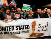 """صور.. مظاهرات لعرب إسرائيل بتل أبيب تحت شعار """"أمريكا رأس الحية"""""""