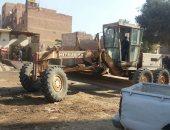 """صور.. حى الهرم ينقل موقف سيارات """"نصرة"""" العشوائى إلى منطقة الشوربجى"""