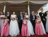 صور.. حفل زواج جماعى لـ50 من الأزواج الصينيين فى سريلانكا