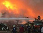 قارئ يشارك بصور من حريق مخزن الخردة فى ميناء دمياط