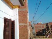 صور.. كهرباء شمال الدلتا تحول الكابلات الهوائية لأرضية بعدة كتل سكنية