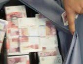 الأموال العامة تضبط تاجر عملة بحوزته 200 ألف ريال سعودى