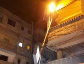 صور.. ميل عمود كهربائى يعرض المارة لخطر الصعق فى شارع 45 بالإسكندرية
