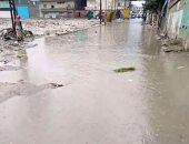 الأمطار تغمر شوارع نجع الرواف والأهالى يستغيثون بمحافظة الإسكندرية
