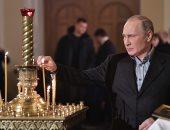 صور.. الرئيس الروسى يحضر احتفالات عيد الميلاد فى كنيسة القديسين