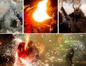 مهرجان النيران يشعل إسبانيا.. والمشاركون يتنكرون فى زى الشيطان