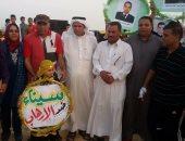 """أسرة شهيد مسجد الروضة """"أبوشميط"""" ترفع شعار بالعلم نقهر الظلام"""