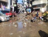 صور.. اضبط مخالفة.. شارع الشرباصى غارق بمياه الأمطار