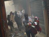 صور.. النيران تلتهم سوق الحديد التاريخى فى هايتى والأهالى يفرون بمنتجاتهم