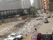 صور.. تراكم القمامة وسط الكتلة السكنية فى الطالبية فيصل يثير غضب الأهالى