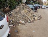 مواطن يشكون تراكم اثار الحفر في شارع وادى النيل بالجيزة