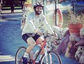 صفحة الدورى الإنجليزى تنشر صورة لمحمد صلاح يقود دراجة فى الشارع