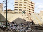 صور.. شكوى من تلال القمامة ومخلفات على سلالم الدائرى المريوطية